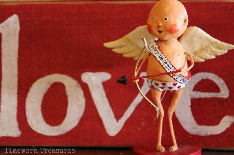 Love sign and Lori Mitchell Designs Cupid