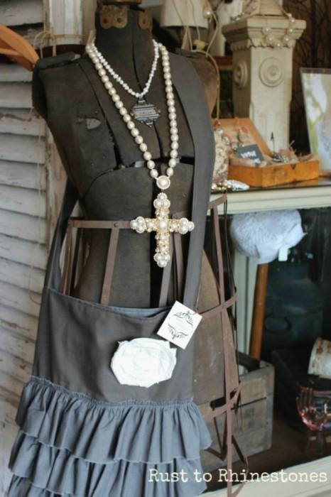 Antique dress form with ruffled handbag