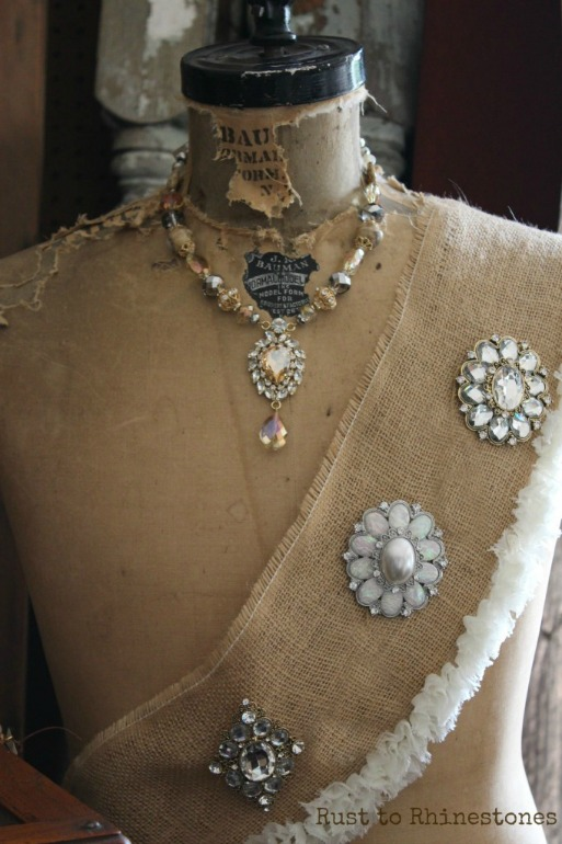 Dress form with necklace and brooches
